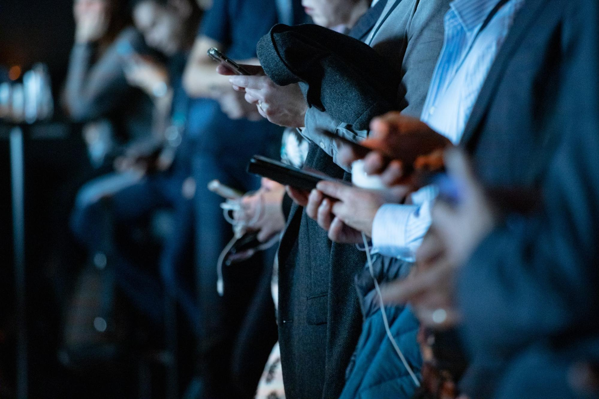 Several individuals using smartphones