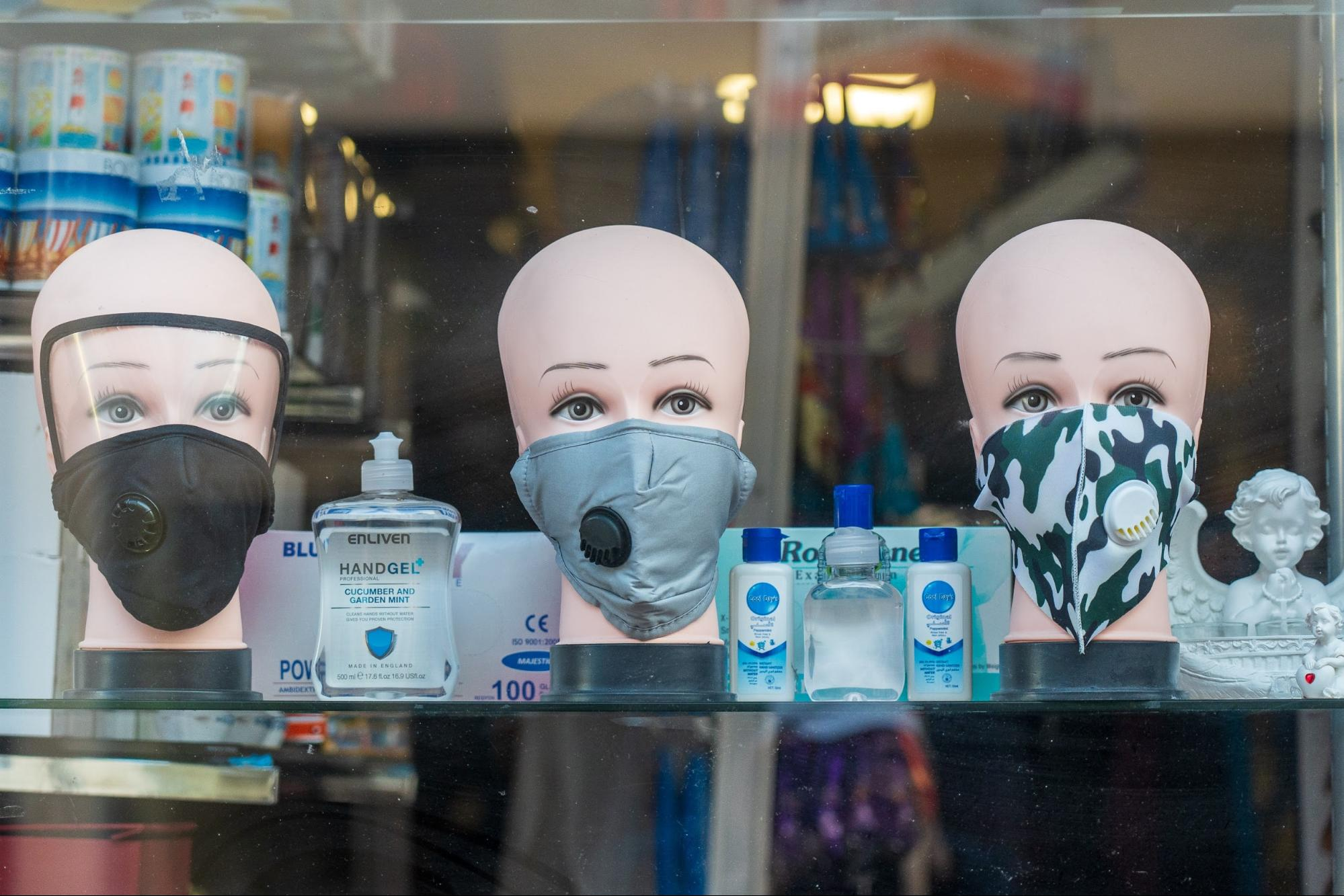 A display of masks and hand sanitizers