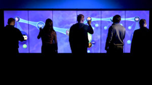 Multiple users interacting with a video wall