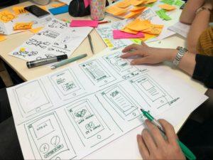 A designer writing up a content plan