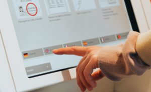 A user interacting with a touchscreen displays