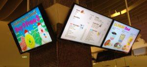 Digital menu screens in a restaurant