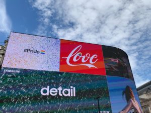 A large digital billboard featuring a variety of ads