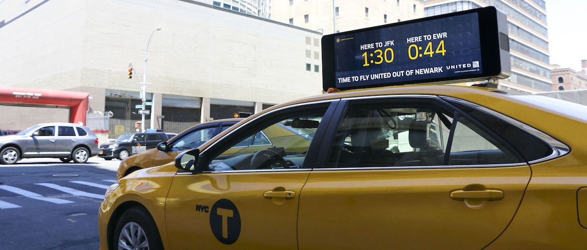 Vehicle mounted digital signage on taxis